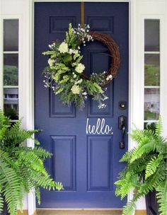 Welcoming door! Love the greenery and hello sign.