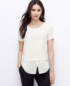 Soft yet structured, this crepe marvel is cleverly constructed with an untucked shirttail hem for a stylish layered effect. Ribbed jewel neck. Short sleeves. Shirttail hem.