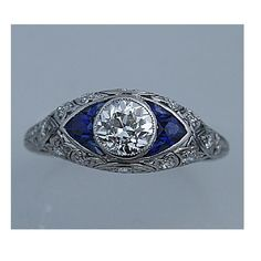 vintage engagement ring - $115000 - 1.40cts, H color, VS2 clarity, platinum, art deco with sapphire accents