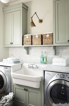 green laundry room cabinets