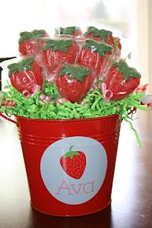 Strawberry shaped chocolate lollipops!
