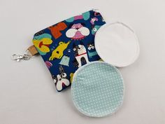 Small zipper pouch with reusable breastfeeding nursing pads set, gifts for her, stocking fillers, unique baby shower gift, crazy dog print Nappy Wallet, Modern Cloth Nappies, Small Zipper Pouch, Nursing Pads, Unique Baby Shower Gifts, Cosmetic Pouch, Waterproof Fabric, Coordinating Fabrics, Crazy Dog