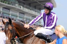 Winner: Joseph O'Brien celebrates with his horse after completing Derby victory by five lengths