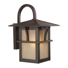 The statuary bronze finish of this Medford outdoor lantern from Sea Gull Lighting creates a warm and inviting presentation for your home's exterior. This light fixture comes complete with etched and hammered light amber glass shades.