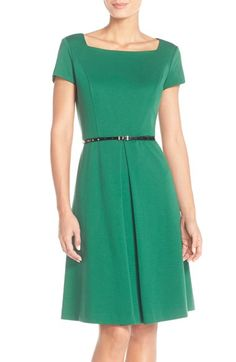 I love the green of course. But I like the neckline and that there is a little arm to it since so many dresses nowadays are completely sleeveless. Although the dress is modest and simple, I'd think it could really be amped up with a statement necklace, shoes, and/or other accessories.