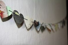 50 paper hearts on string taken from recycled books by Attic Journals Wedding Silverware, Crafts To Make, Arts And Crafts, Recycled Books, Heart Garland, Paper Hearts, Book Pages, Clock, Valentines
