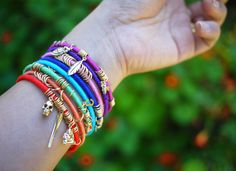 bangles, embroidery floss, charms, jump rings . . . bam!!  cute summery bracelets