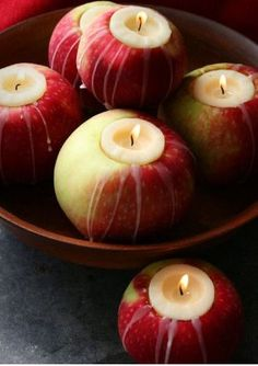 Apple candles cute for a fall wedding. I actually have the tool to cut them for votive size.