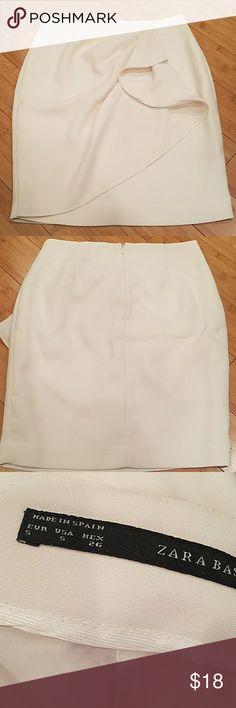 "Zara Basic cream skirt Tag shows Sz 5 Excellent condition! Draped frt design Back zipper Fully lined Above knee length So feminine! 13 1/2"" waist 17 1/2"" hip 19"" length Made in Spain Price is firm! Zara Skirts"