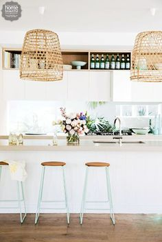 Gorgeous but I can't even imagine how dirty those wicker light shades would get.