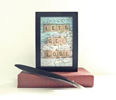 "Framed vintage map with vintage scrabble ties and the phrase "" Let's Get Lost"". Description from etsy.com. I searched for this on bing.com/images"