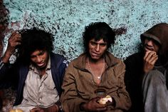 Three homeless boys have just woken up after a night of drugs and short sleep in a ruined house (Lima, Peru; December 2005).