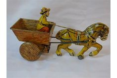 Vintage tin plate clockwork horse and farm carriage