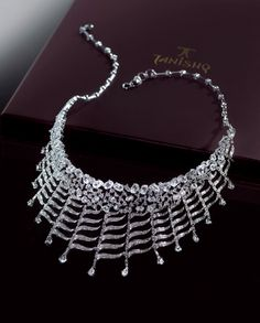 Brilliant-cut & pear-shaped diamonds in 18K gold necklace by Tanishq
