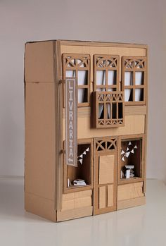 Totally cute!! I remember making one over 10 yrs ago for daughter but it was only 1 story | Cardboard house