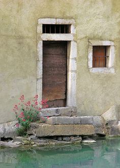 Doorway on to the canal in Annecy, France. Photo by Alan Summers.