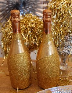 Champagne bottles covered in gold glitter....love it!