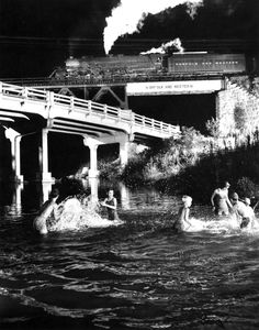 O. Winston Link (Dec. 16, 1914 - 2001): Hawksvill Creek Swimming Hole, Luray, Virginia, 1956 - gelatin silver print Born                in Brooklyn, New York, in 1914, Link worked as a commercial photographer.                He displayed great skill in making industrial photographs that required special camera techniques and lighting                effects. O.                Winston Link's photographs of the final years of steam railroading                on the Norfolk & Western Railway...