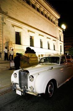 A white vintage Rolls Royce was the ideal getaway car for Ali and Steve's formal, vintage-inspired celebration.