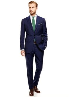 Navy suit and green tie