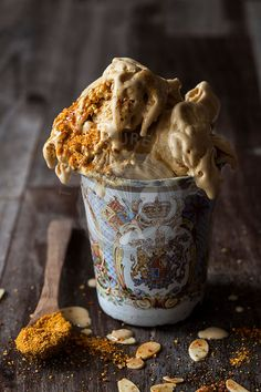 Melting honeycomb and roasted almond ice cream served in vintage cup