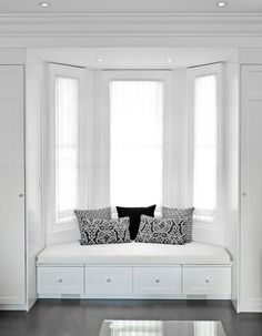 Crisp white window seating, photography by http://www.bofoto.ca/