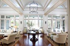Living room sofa table flowers design coverlet lighting large room idea TV white