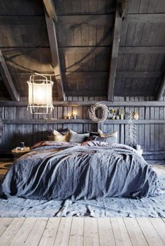 The owner of Milla Boutique has made this fantastic bedroom in an old barn. Painted with Fresco lime paint in the color Black Truffle from Pure & Original. Cred. Camilla Berntsen/Tone Kroken/Yvonne Willhelmsen