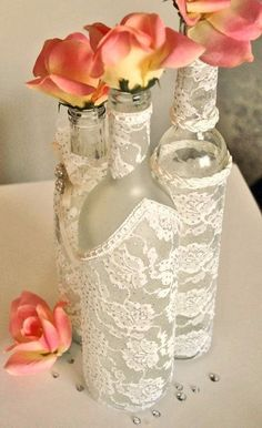 DIY Wine bottles wrapped in lace for centerpieces Photo Source:sortrachen #winebotles #lace #centerpiece