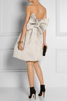 Lanvin dress, Erickson Beamon earrings, Anndra Neen cuff, Aurélie Bidermann ring, Dolce & Gabbana boots, Kotur clutch.