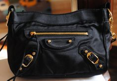 Balenciaga Black Satin Shoulder Wristlet Pouch Clutch Makeup Bag! I loved it so much I got it in Le Lilac too. Le meaning limited Edition! I had them both!