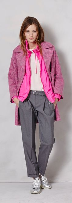 This winter, use your layering to add a pop of bright color to your look. This look combines a bright, functional pink nylon jacket underneath a more muted, but still vibrant pink and grey overcoat. Classy, sassy, perfect.