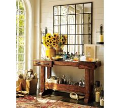 The ultimate bar set. I'm looking to do one in my living room. Love Pottery Barn's Square Decanters, featured here.