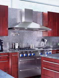 For all you stainless steel lovers out there...if you can't afford the appliances, here's a great alternative. This backsplash is a beauty.