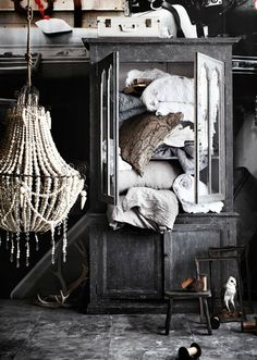 chandeleir -- adore how it made out of shells! I wouldn't hide this in my closet it would have to go in a guest bedroom!
