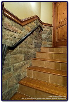 basement stairs.  I don't like the tile on the stairs but I do like the chair rail and stone on the wall.