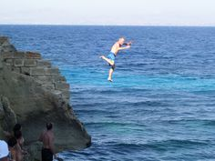 A huge leap for Jim during our afternoon on the island of Favignana off trapani, Sicily www.tuscanytennis.com