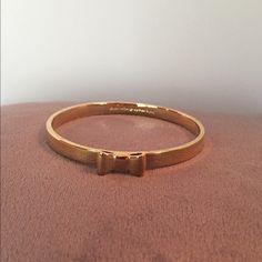 "Kate Spade Take A Bow Bracelet Gold tone bangle bracelet with trademark Kate Spade bow. Band width is .25"", diameter is 2.5"". kate spade Jewelry Bracelets"
