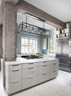 modern kitchends with brick wall design, and an attractive pendant lamp