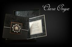 black and ivory flocked pocket wedding invitation with satin and rhinestone flower