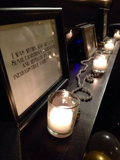 great decorations....gatsby quotes, pearls and candles.  Roaring 20s Gatsby Party