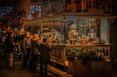 Valencia: 'Churros Seller, Fallas', 11pm, by Ian Monk.   31 Beautiful Photos Of Cities That Never Sleep