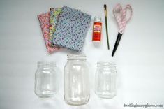 Spring Mason Jar Vases :: Hometalk cut fabric that will fit the mason jar by wrapping the fabric around the jar. Cut fabric into long strips. Modgepodge the fabric after placing strips inside the jar. Or can paste OUTSIDE the jar. Mason Jar Vases, Mason Jar Flowers, Mason Jar Crafts, Mason Jar Diy, Bottle Crafts, Decoupage, Old Baskets, Pickle Jars, Painted Mason Jars