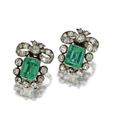 PAIR OF EMERALD AND DIAMOND EARCLIPS, LAST QUARTER 19TH CENTURY The 2 emerald-cut emeralds weighing approximately 8.00 carats, framed by old-mine diamonds and topped by diamond-set bows, the whole set with 44 old-mine diamonds weighing approximately 6.50 carats, fitted with modern clip-backs.