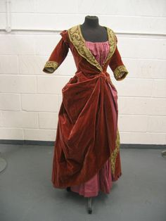 """""""A pink velvet ball gown by Madame Desfemmes, Paris, circa 1895-90, comprising: open-robe of raspberry velvet with gold lace trimmings, mauve faille and pink taffeta skirt"""""""