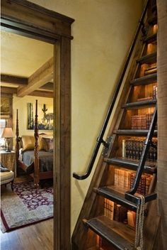 Holy cow, these bookshelf stairs are particularly gorgeous! I love the industrial looking rails - and for that matter, the bedroom beyond.