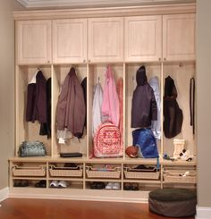 Love the organised mudroom. Some different colours would make it look brighter