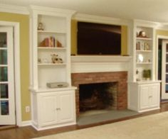 I probably like this update the best. Blue stone slab for hearth. I might even like the wall colors. I like the recessed look, and the cabinets on either side. Wonder if we could pull that off and cover the seat. Oh to put a TV there... (DIY Network video)