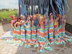 mermaid tails made with beach towels, Velcro around the waist and hair elastic a to define the fins. Awesome!
