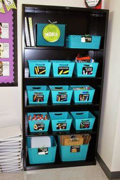 So many different organization ideas on this post, but this is my favorite. Organizing supplies for 30+ kids is tough, but matching baskets and coordinating labels makes it manageable. Love the pop of color in this classroom supply bookshelf. Ladybugs teacher files is my go to for labels, too